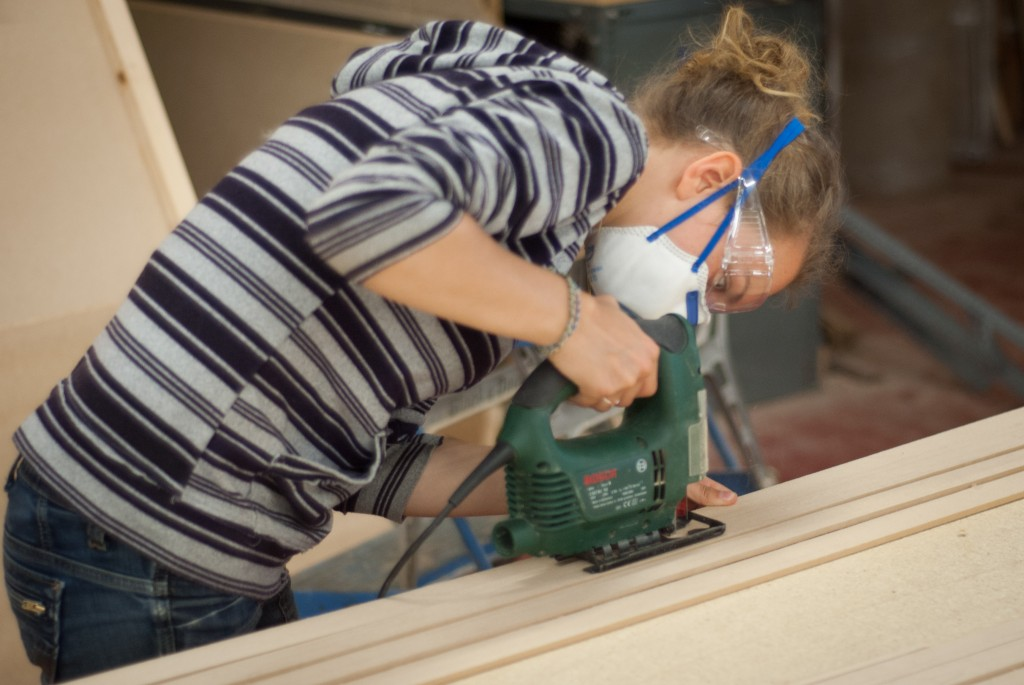 Using a jig-saw to cut flutes into the decorative 'columns'